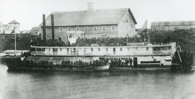 "The steamboat ""International"" and barge ""Harty"" arrive at Fort Garry with 380 Mennonite colonists, the first such group to arrive in Manitoba, 1874"