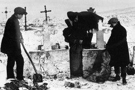 seizing grain from kulaks which was hidden in the graveyard, Ukraine