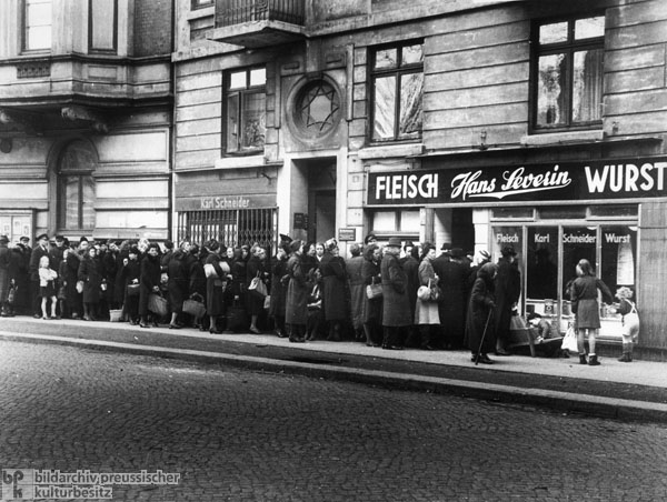 Waiting for Special Rations Line in Front of a Butcher Shop in Hamburg-Winterhude